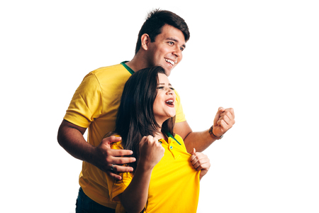 Brazilian couple fan celebrate on white background Archivio Fotografico