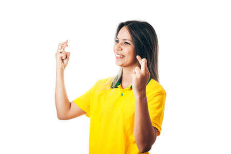 Nervous football fan in yellow on white background Stock Photo