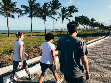 Cabedelo, Paraiba, Brazil - October 2, 2018 - People walks near the beach on a sunny day