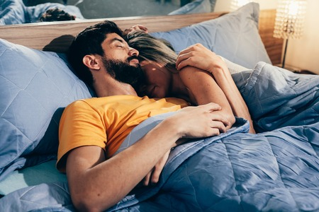 Couple sleeping in bed. The sleeping couple relax in the bed. night time Stock Photo