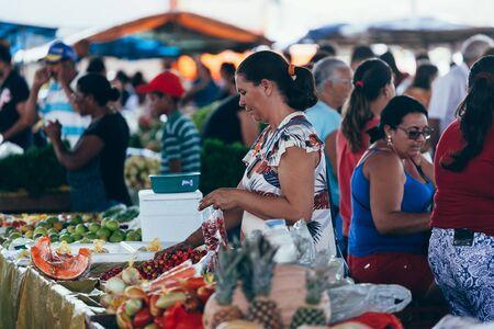 Sao Jose do Egito, Pernambuco, Brazil - September 29, 2018 - Woman buys at local farmers market in Brazil Sajtókép