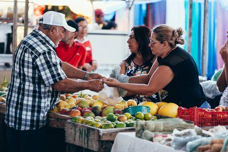 Sao Jose do Egito, Pernambuco, Brazil - September 29, 2018 - Seller works in the local farmers market in Brazil Sajtókép