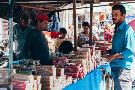 Sao Jose do Egito, Pernambuco, Brazil - September 29, 2018 - Man sells homemade sweets at the local farmers market in Brazil Sajtókép
