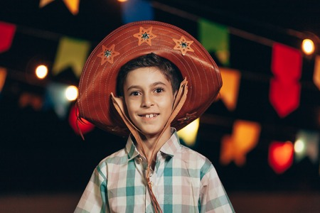 Brazilian boy wearing typical clothes for the Festa Junina - June festival