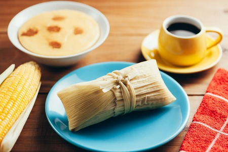 Typical food of Brazilian Festa Junina - June Festival. Pamonha and coffee Banco de Imagens