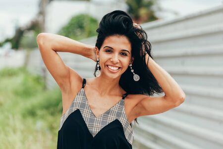 Portrait of beautiful mixed race woman in the city
