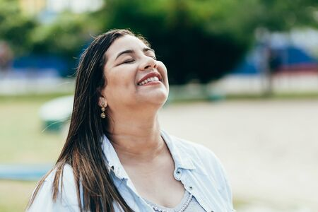 Portrait of beautiful plus size woman in the park