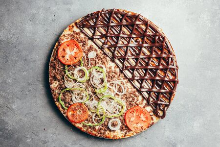 Flat lay of delicious pizza on gray background Stock Photo