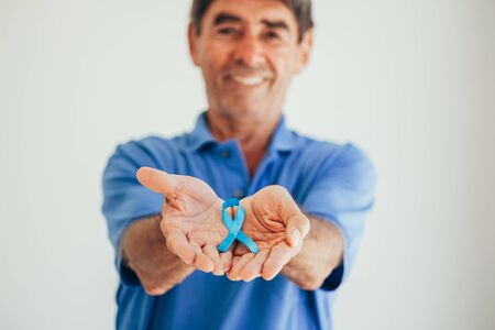 Prostate Cancer Awareness. Man with light Blue Ribbon for supporting people living and illness. Men Healthcare and World cancer day concept Stock fotó