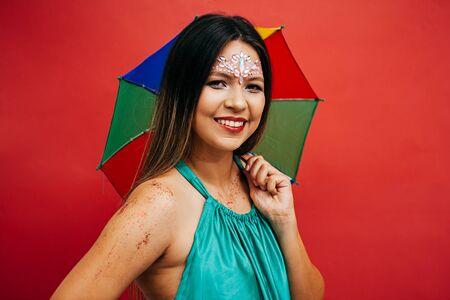 Young woman celebrating the Brazilian carnival party with Frevo umbrella Archivio Fotografico - 140758409