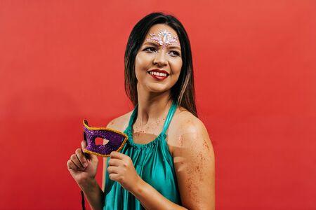 Masquerade woman celebrating the Brazilian carnival party Archivio Fotografico - 140758483