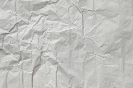Creative background with scattered overlay of crumpled papers.