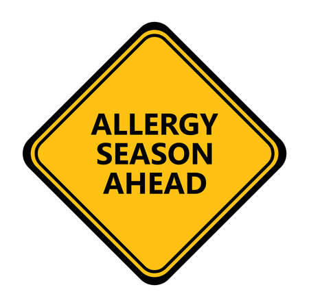 Yellow allergy season ahead sign