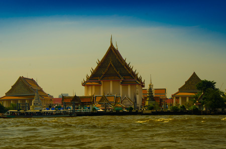 Historical building of temple and royal palace by the edge of the river in tropical Asian country 版權商用圖片