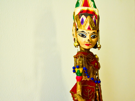 Wooden artistic sculptured toy of gorgeous and beautiful female princess with traditional dress, crown and jewelry