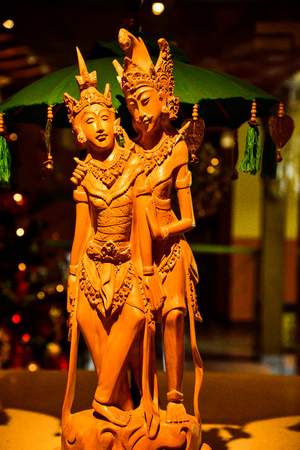 Wooden artistic sculptured toy of gorgeous and beautiful female princess and male prince with traditional dress, crown and jewelry