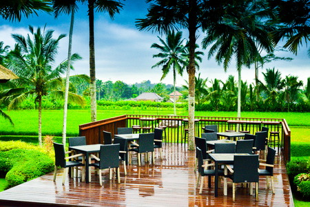 Gorgeous romantic outdoor dining area and view of rice terrace in the fresh air morning for family children school holiday retreat and honeymoon vacation in South East Asia Imagens
