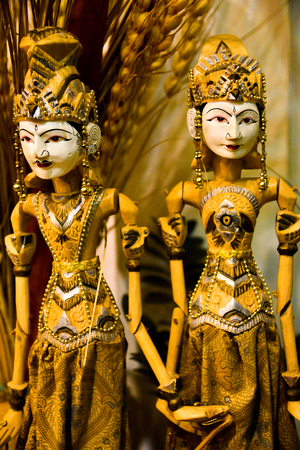 Traditional wooden sculpture toy puppet of king and queen wearing traditional clothing and ornaments Stock Photo