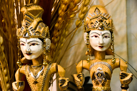 Traditional wooden sculpture toy puppet of royal king and queen wearing traditional clothing and ornaments Stock Photo