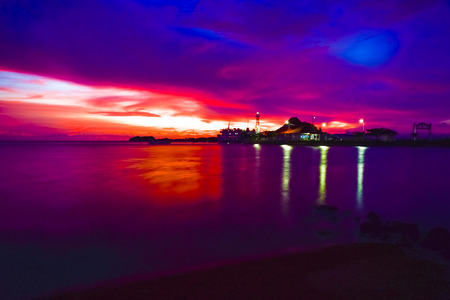 Gorgeous romantic purple blue sunset on a sandy beach in Indian Pacific sea ocean in South East Asia Stock Photo