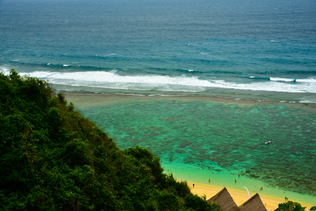 Fresh morning view of Indian Pacific sea ocean with yellow sandy beach and gazebo from top of the hill for honeymoon vacation