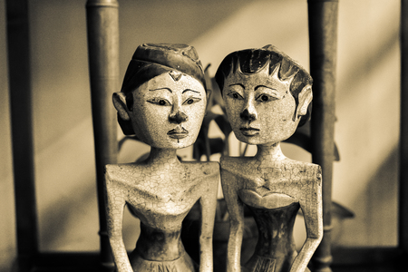 Wooden sculptured toy of gorgeous and beautiful husband and wife with traditional dress, crown and jewellery
