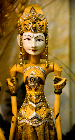 Wooden sculptured toy of gorgeous and beautiful queen with traditional dress, crown and jewellery