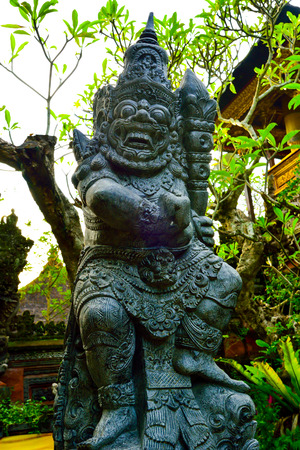 Stone giant beast sculpture statue guarding a sacred temple in South East Asia