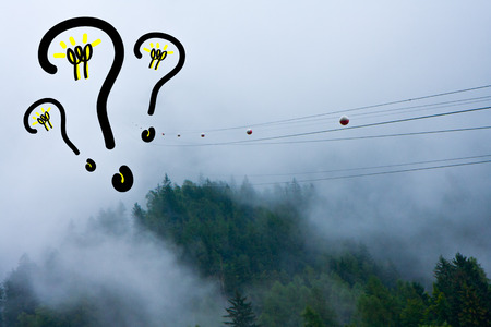 high-tension wires that disappear into the clouds