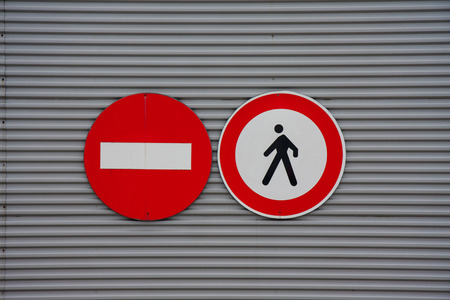 Prohibiting sign pedestrian access on metal wall photo