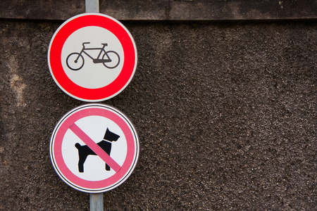 prohibiting: two signs prohibiting bicycles and dogs
