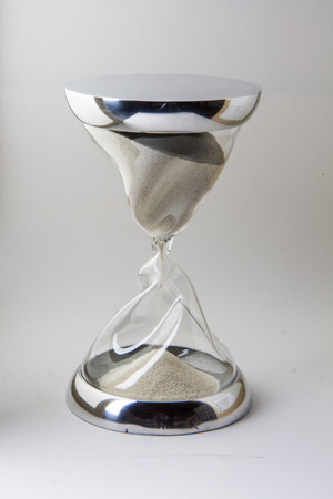 closure: hourglass closeup with twisted glass and steel closure