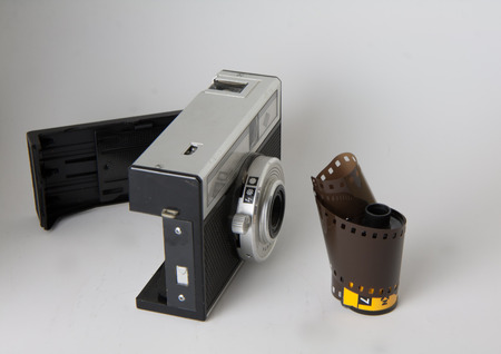 compact camera: closeup of old compact camera with roll film Stock Photo
