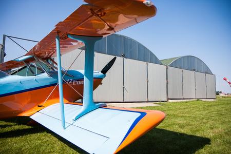 light aircraft: light aircraft, modern biplane orange and blue details and takeoff