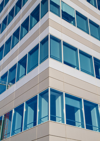 property management: detail of a facade of a modern building with glass Stock Photo