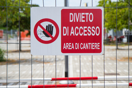 close up fence with a sign prohibiting access area site Stock Photo