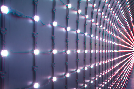 leds: dark background with multicolored LEDs in perspective