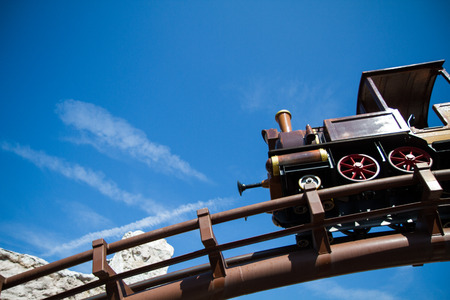 old west: detail of roller coaster steam locomotive old west Stock Photo