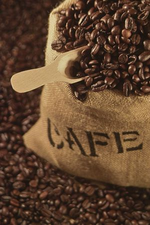 freshly roasted coffee beans in a sack