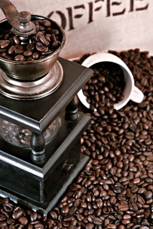 fresh roasted coffee beans with hand mill photo