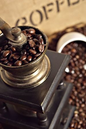 fresh roasted coffee beans with hand mill