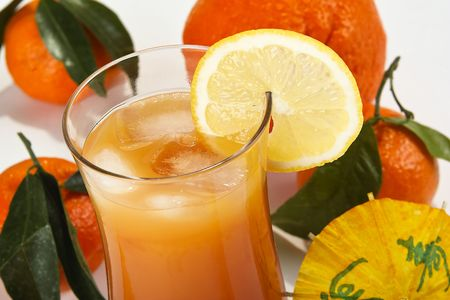 Orange juice in a glass with fresh fruits