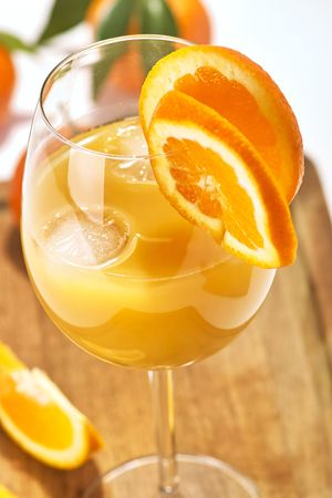 Orange juice in a glass with fresh fruits photo