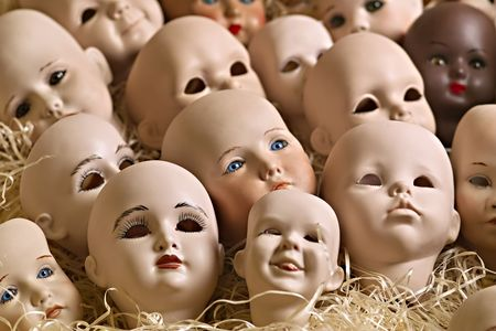 Doll heads of porcelain in a box with wood-wool Stock Photo - 6828716