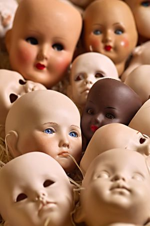 head toy: Doll heads of porcelain in a box with wood-wool