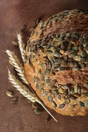 round pumpkin core bread with wheat ears decorates Stock Photo