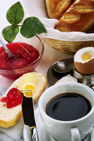 Breakfast cover with bread roll, butter, jam and egg Stock Photo