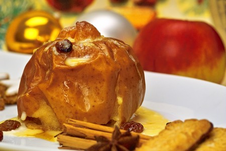 Roast apple on a white plate with decoration
