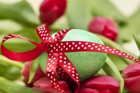 Easter egg with spotted with red loop  Stock Photo