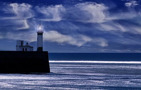 lighthouse in Mer les Bain,france,while the moon is shining